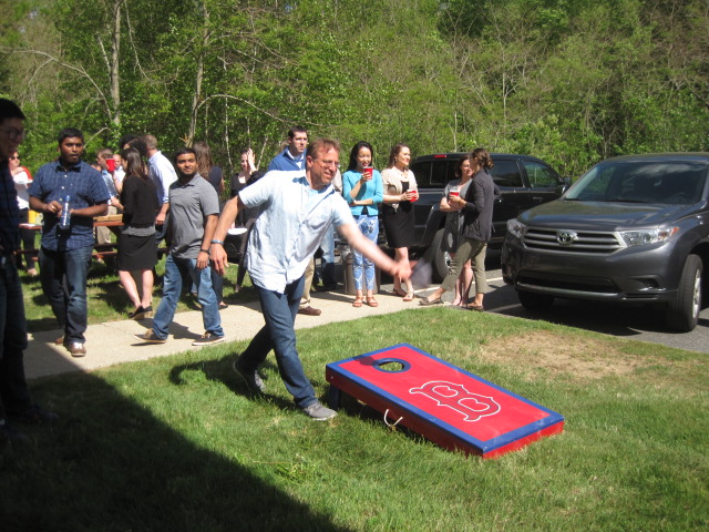 Veristat Employees Playing Cornhole Toss Games